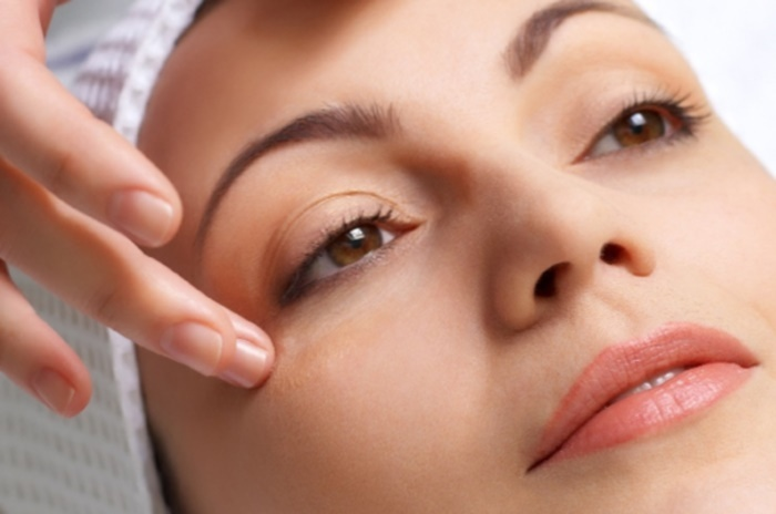 applying of vitamin treatment for facial skin in the beauty salon